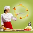 Asian female chef slicing oranges — Stock Photo