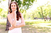 Portrait of an attractive woman in the park — Stock Photo