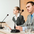 Businessmen communicate at conference — Stock Photo #24396061