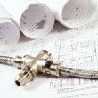 Plumbing and drawings, construction still life - Stockfoto