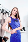 Young woman in mall buying clothes — Stockfoto