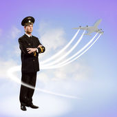 Pilot is in the form of arms crossed — Stock Photo