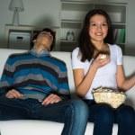 Woman watching television at home — Stock Photo #24439799