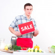 Portrait of a young man, hold sale mark — Stock Photo