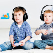 Two brothers playing on games console — Stock Photo #24440011