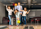 Group of young friends playing bowling — Stock Photo