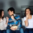 Group of young watching TV on the couch — Stock Photo #24863877