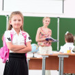 Portrait of schoolgirl with backpack - Stockfoto