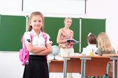 Portrait of schoolgirl with backpack — Stock Photo