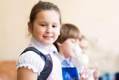 Portrait of Asian girl in apron painting — Stock Photo