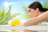 Beautiful spa woman lying on the couch — Stock Photo