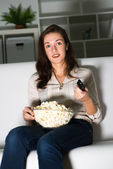 Young woman watching TV — Stock Photo
