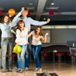 Group of young friends playing bowling — Stok Fotoğraf #25240739