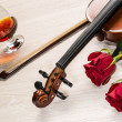 Violin, rose, glass of champagne and music books - Stock Photo