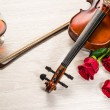 Violin, rose, glass of champagne and music books — Stock Photo #25241017