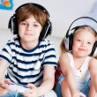 Cute boy and girl playing gaming console — Stock Photo