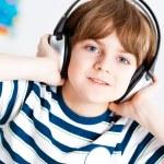 Boy listening to music — Stock Photo #25241481