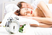Beautiful woman sleeping on the bed — Stock Photo