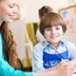 Teacher and student in the classroom — Stock Photo #25666731