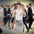 Young blindfolded woman - Stock Photo