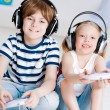 Cute boy and girl playing gaming console — Stock Photo #25666893