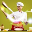 Asian female chef in the kitchen conjures — Stock Photo #25667123
