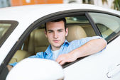 Portrait of a man in a car — Stock Photo