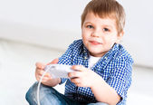 Boy playing on a game console — Stock Photo