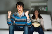 Guy with a passion watching TV — Stock Photo