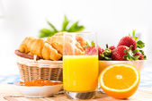 Early breakfast, juice, croissants and jam — Stock Photo