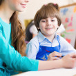 Teacher and student in the classroom — Stock Photo #26133715