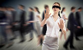 Young blindfolded woman — Stock Photo
