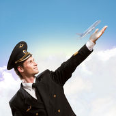 形式的扩展的手,将飞机的飞行员 — 图库照片