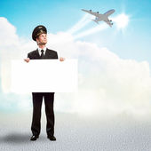 Pilot in the form of holding an empty billboard — Stockfoto