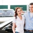 Stock Photo: Young couple in the showroom