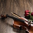 Violin, rose, glass of champagne and music books — Stock Photo