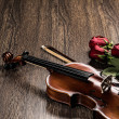 Violin, rose, glass of champagne and music books — Stock Photo #26601415