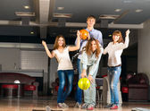 Group of young friends playing bowling — Stok fotoğraf