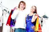 Shopping smile couple at the mall — Stock Photo