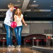 Young couple plays bowling — Stock Photo #27771883
