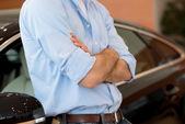 Man standing near a car — Stock Photo
