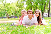 Family lying in the park — Stock Photo