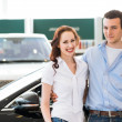 Young couple in the showroom — Stock Photo