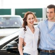 Young couple in the showroom — Stock Photo #28610263