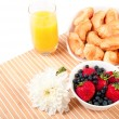 Stock Photo: Breakfast with berries,orange juice and croissant