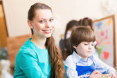 Teacher and student in the classroom — Stock Photo