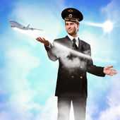 Pilot in the form of extending a hand to airplane — Stock Photo