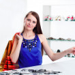 Stock Photo: Womat shopping checkout paying credit card