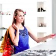 Stock Photo: Woman at shopping checkout paying credit card
