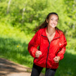 Healthy young female athlete running — Stock Photo